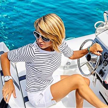 girl driving a boat nautical style classy and sexy nautystyles